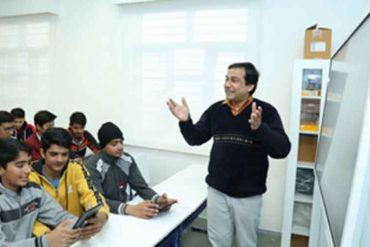 A JNV school teacher teaching in one of the existing Samsung Smart Classes.