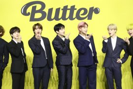 """BTS members pose for photo during a press conference held after releasing new digital single """"Butter"""" on May 21. (Yonhap)"""